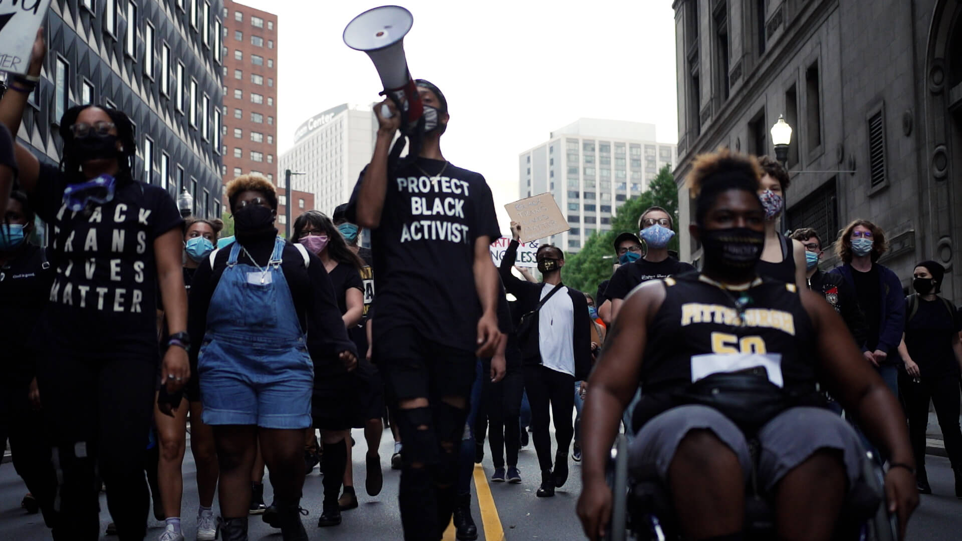 Pittsburgh activists walk down a downtown street.