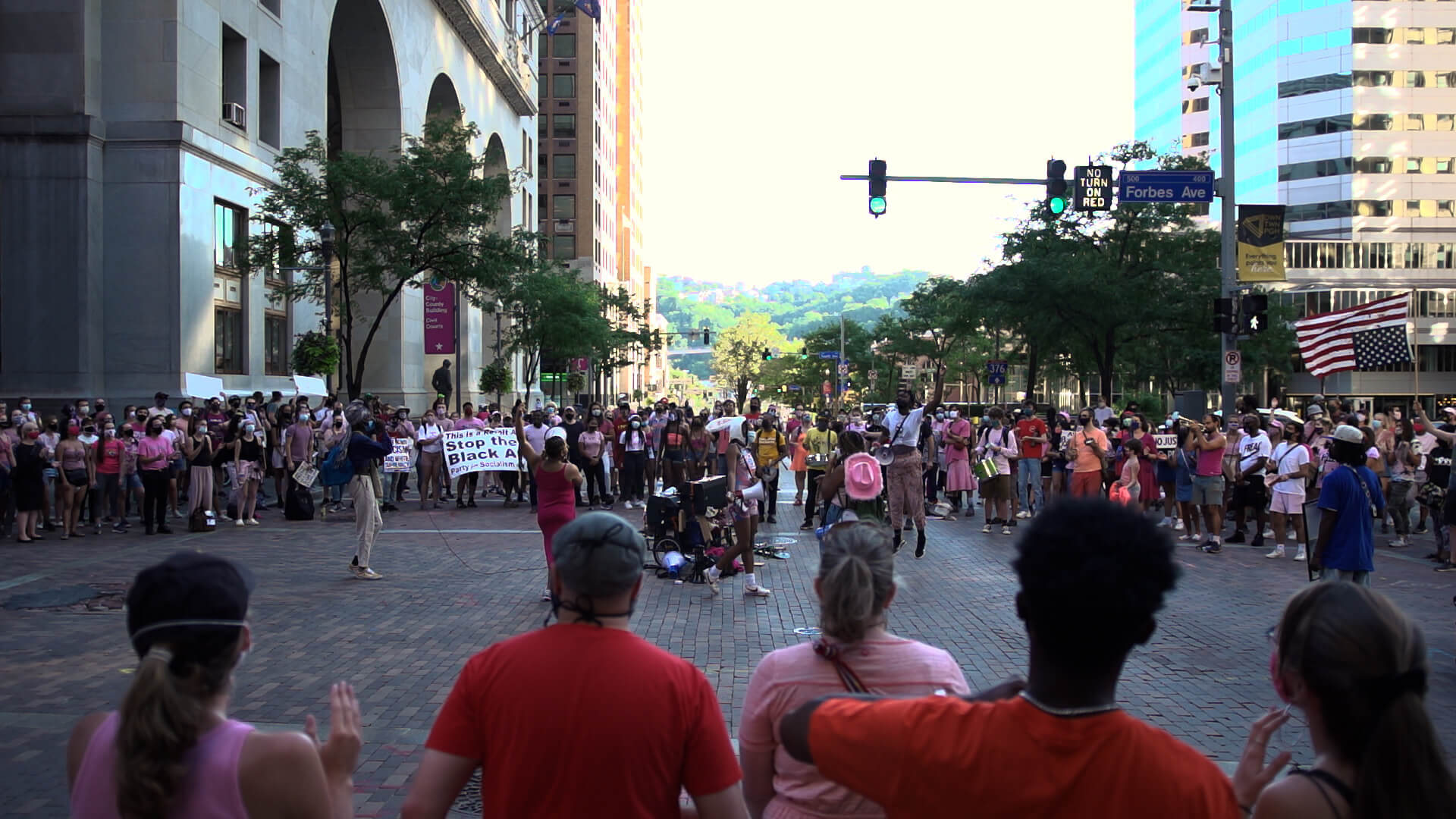 Protesters gather outside the City-County Building in downtown Pittsburgh, many dressed in pink.